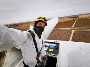 Darkon London-Wainwright on top of a wind turbine, fields, working for gev